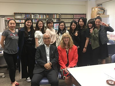 Photo of Jackie, in Japan with a university instructor and student group