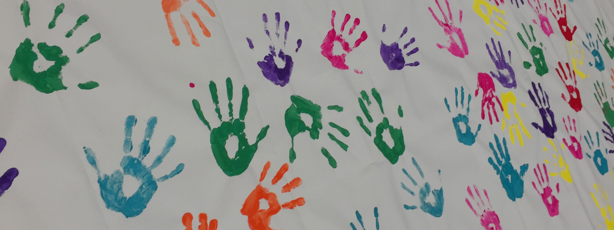 Colourful handprints on canvas