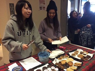 Photo of ELC students running a bake sale.