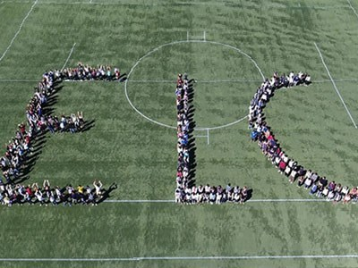 Aerial view of students forming the letters ELC