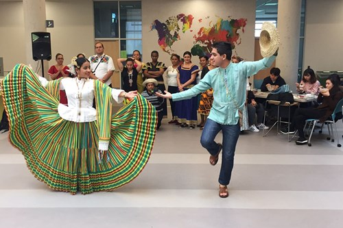 Panamanian teachers take a break from their studies to share a cultural performance. Photo Credit: Susan Abrill.